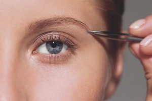 How to pull out eyebrows without pain